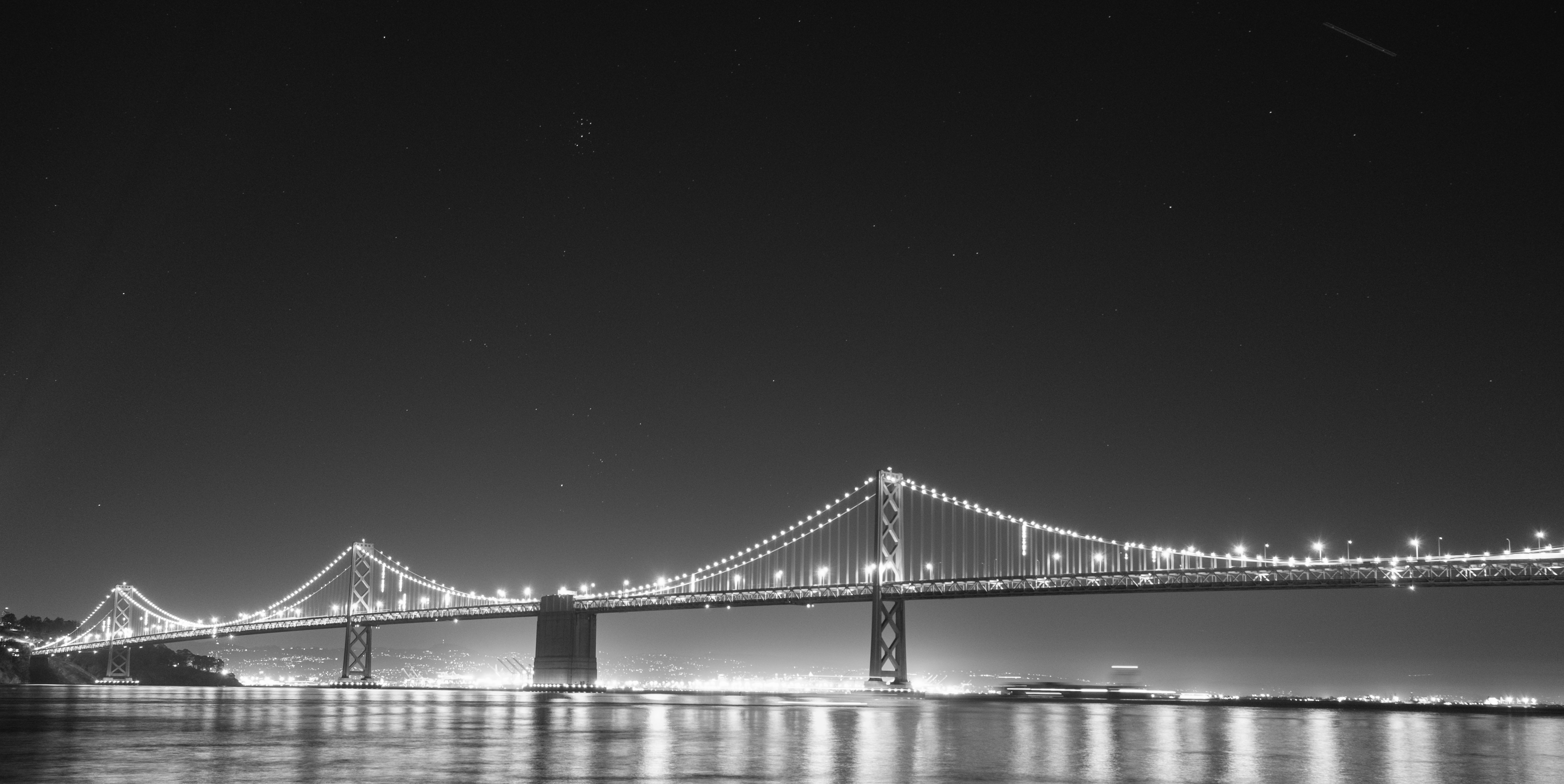 A night time photo of the Bay Bridge.