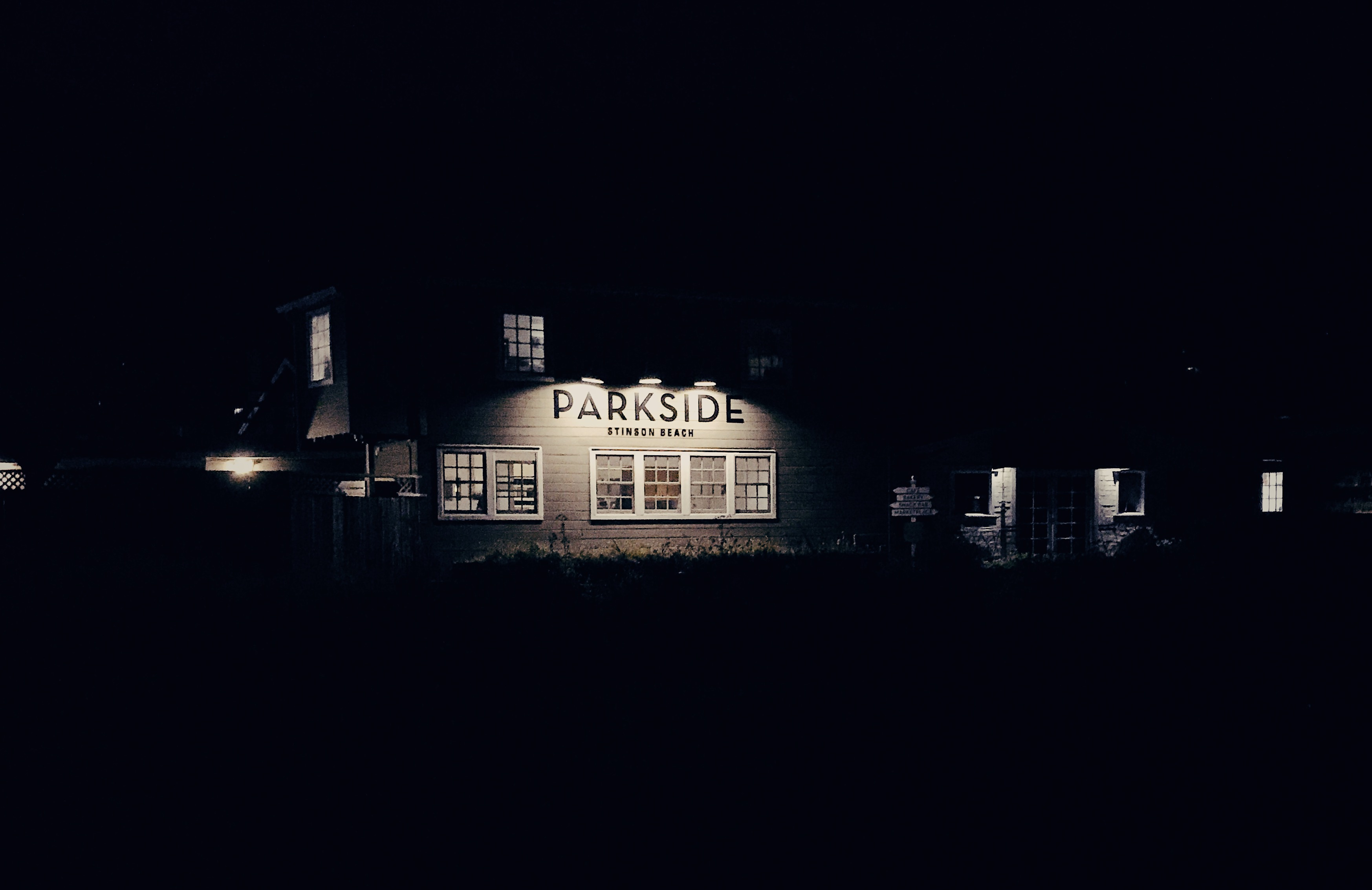 A night time photograph of the Parkside Grill in Stinson Beach, CA.